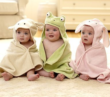 I have a thing for hooded towels....love the babies' expressions, I wonder what the photographer was doing off-camera ;-)
