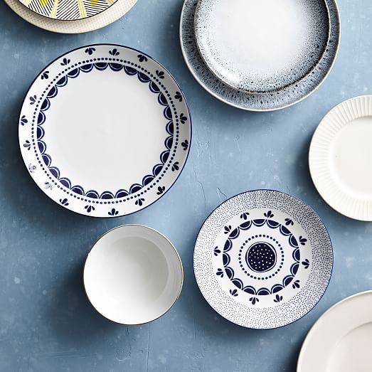 Stamped and hand-painted scallop dinnerware inspired by Delftware designs