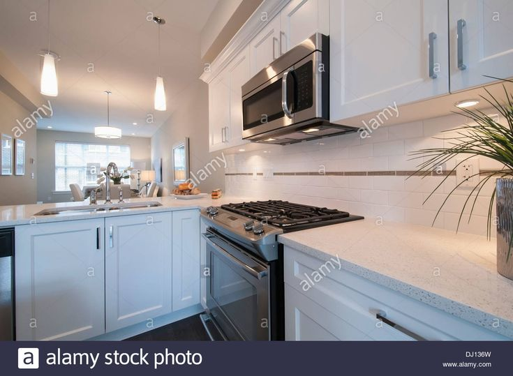Download this stock image: Stove And Built-In Microwave Oven In Modern Kitchen; Surrey, British Columbia, Canada - DJ136W from Alamy's library of millions of high resolution stock photos, illustrations and vectors.