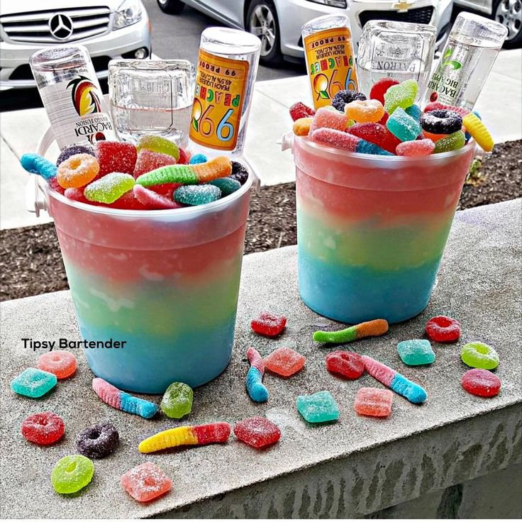 SUPER CANDY COLLISION  Blue:  Patron Tequila Blue Curacao Margarita Mix Berry Blue Typhoon Hawaiian Punch Juice  Yellow:  Peach Schnapps Pineapple Juice Sour Mix  Mango Rum  Red: Cherry Pucker Cherry UV Vodka Fruit Punch Juice  Lemon Juice
