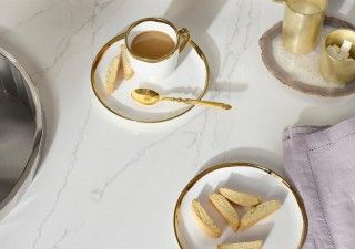 Silestone External Gold Calacatta  Countertop    Creamy white quartz with elegant grey veining sets the standard for the occasion: after-dinner coffee and biscotti for one—or two.