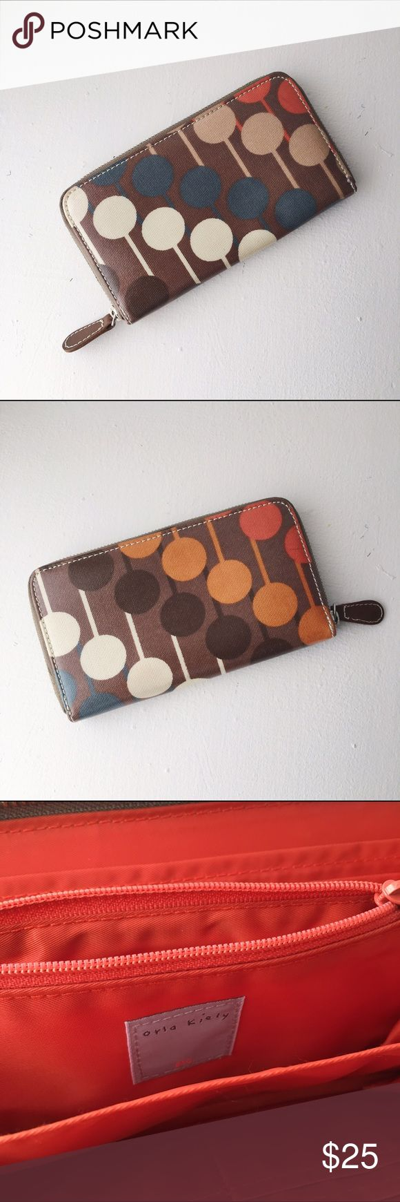 Orla Kiely Wallet Orla Kiely oil cloth printed wallet. In excellent used condition.  Shows some minor dirt in the change purse pocket.  Used very gently. Orla Kiely Bags Wallets