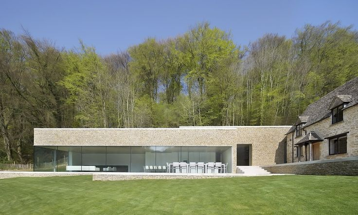 Old English country home in the Cotswolds with minimalist modern addition. Architect: Found Associates, photographer Hufton + Crow.