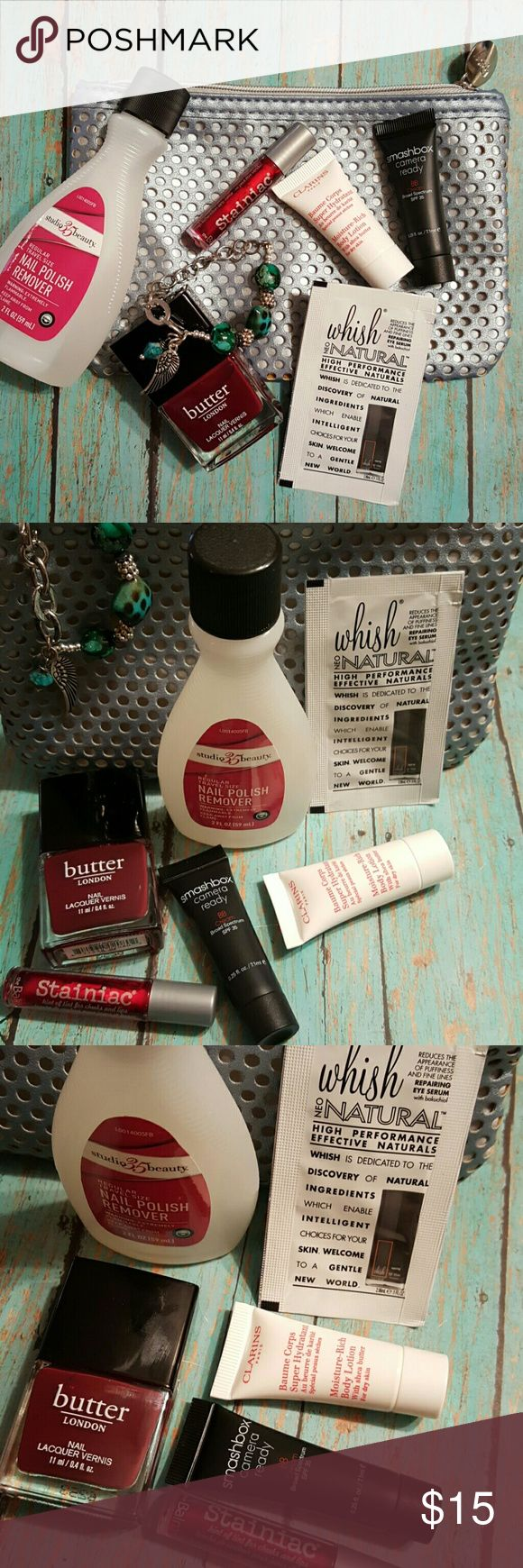 "Goody Bag Bundle Ipsy Cosmetic Bag (new), Gypsy Soul bracelet (new), Butter London Nail Lacquer in Ruby Murray (new), Clarins Moisture Rich Lotion sample (new), Smashbox Camera Ready sample in Light/Medium sample (new), theBalm Stainiac for lips & cheeks in ""beauty queen"" (new), Whisk eye serum sample (new), 2oz Nail Polish Remover (new). Makeup"