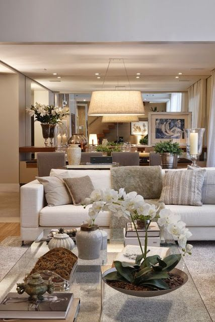 beautiful traditional style decor in a neutral color palette living room. Love this along with the rest of the house featured.