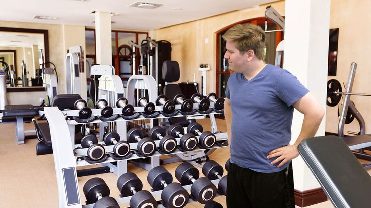 EAGAN, MN—After tentatively approaching the extensive rack of dumbbells located along the gym's wall, new Bally Total Fitness member Brian Vinje was seen lingering in the vicinity of the free weights for several seconds Thursday before returni...