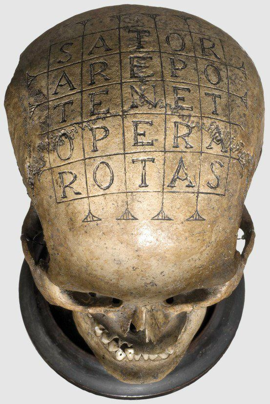 Skull with magic quader 16/17th century Sator Opera Tenet.    The Sator Square is a word square containing a Latin palindrome featuring the words SATOR AREPO TENET OPERA ROTAS written in a square so that they may be read top-to-bottom, bottom-to-top, left-to-right, and right-to-left. The earliest known appearance of the square was found in the ruins of Pompeii which was buried in the ash of Mt. Vesuvius in 79 AD.