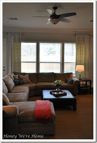 Nice site shows before and after pictures with curtains on short curtain rods.