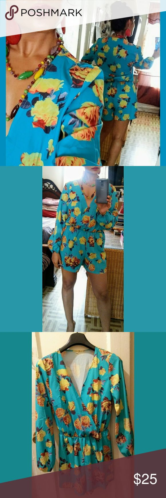 """Flower Power Romper Turquoise with lively, yellow and orange roses. Deep """"V"""" cut adds a seductive touch. Soft, lightweight fabric. Long sleeve- cinched wrist. Elastic waist provides a comfortable """"One Size"""" fit. I am a size 4-6, so you can tell how it fits.  Wanna be noticed?  Paired with fun, colorful accessories, this is definitely a statement outfit! Other"""