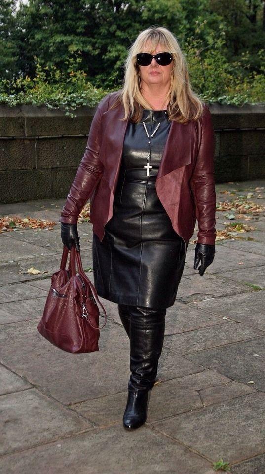 Leather Mistress (Leather Suzy) wearing dress, coat