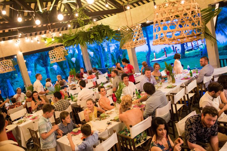 Have an outdoorsy feel to your wedding reception by the river with plants and brightly coloured flowers. #HoiAnEventsWeddings #HoiAn