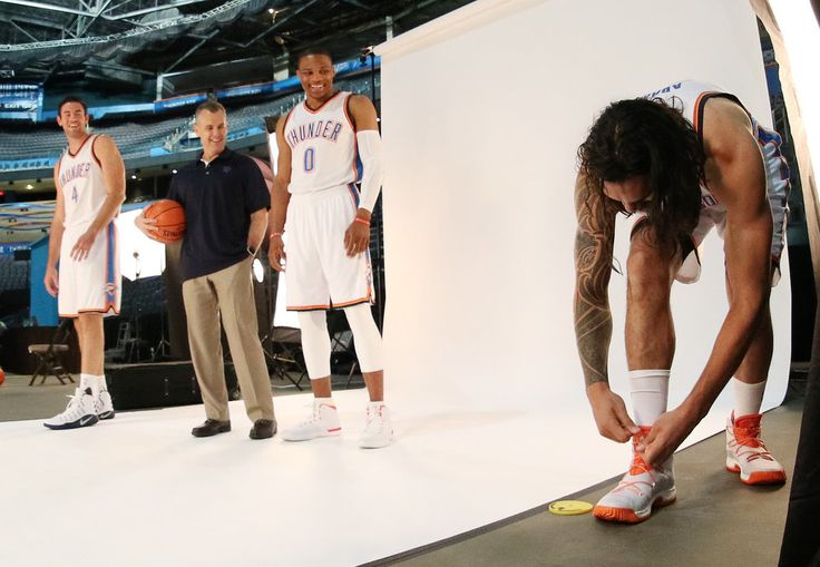 Steven Adams ties his shoes as Nick Collison, Coach Billy Donovan and Russell Westbrook wait during the Oklahoma City Thunder media day, Friday, September 23, 2016. Photo by Doug Hoke, The Oklahoman