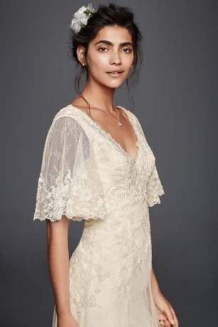 Designed with the free-spirited bride in mind, this lace A-line wedding dress imbues vintage romance. The bell sleeves, V-neckline, and hem are trimmed with beaded lace appliques.  Melissa Sweet, exclusively at David's Bridal.  This style includes Plus Sizes from Style 8MS251163 as seen in the