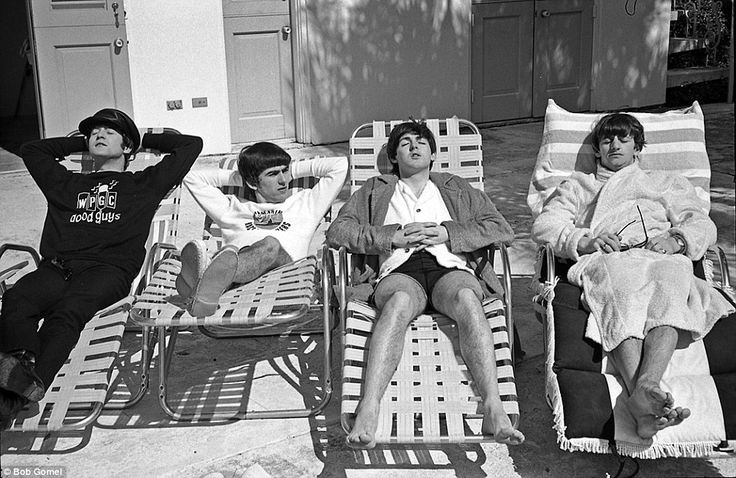 On the cusp of global fame: Rare photos have just been uncovered of The Beatles during their first trip to America in 1964