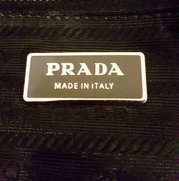 AUTHENTIC BLACK WITH SILVER HARDWARE PRADA HANDBAG Pre-loved Prada Handbag Great Condition no holes. This handbag have a few scratches but nothing major. Prada Bags Shoulder Bags