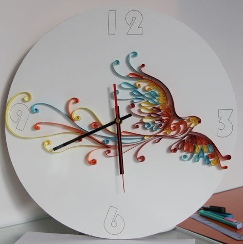 This artistic quilling phoenix clock is created on top of a real clock, the phoenix is created by using thin strips of paper, the phoenix graph is first designed and then later glue all the small modules to form the beautiful quilled phoenix. The completed quilled craft is a beautiful phoenix which is nicely decorated inside of a clock.
