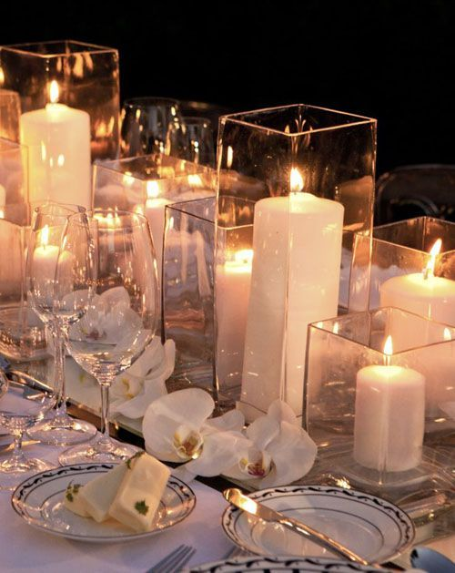 Maybe for the long tables...just candle light on a bed of rose petals?
