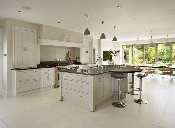 Bespoke open plan Martin Moore kitchen featuring a wooden breakfast bar martinmoore.com