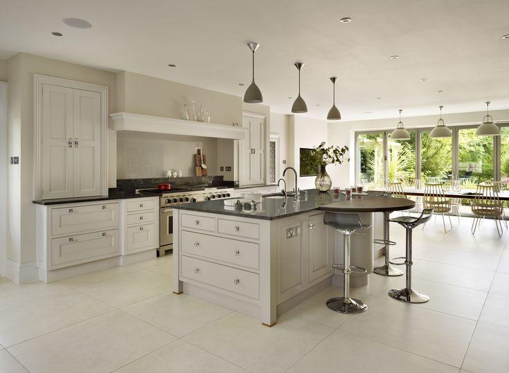 Bespoke open plan Martin Moore kitchen featuring a wooden breakfast bar martinmoore.com