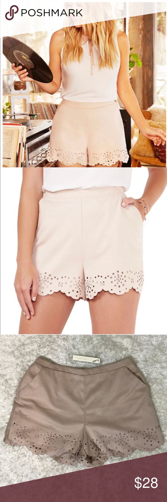 "LC Lauren Conrad faux suede shorts eyelet scallop Color-neutral blush Patched and pieced Lasercut  Elevate your warm weather wardrobe with these women's faux-suede shorts from LC Lauren Conrad. The scalloped eyelet hem adds a sophisticated touch to your casual style.  PRODUCT FEATURES 	•	Scalloped hem with eyelet details 	•	2-pocket 	•	Faux-suede construction 	•	Lined FIT & SIZING 	•	Midrise sits above the hip 	•	Elastic waistband Measurements taken laying flat Waist-15"" Rise-11.5""…"