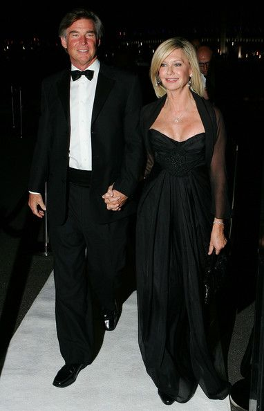 Olivia Newton-John Photos Photos - Olivia Newton-John and husband John Easterling arrive at the 2010 Precious Metal Ball in support of the Olivia Newton-John Cancer and Wellness Centre at Peninsula, the Docklands on May 21, 2010 in Melbourne, Australia. - Celebrities Attend 2010 Precious Metal Ball