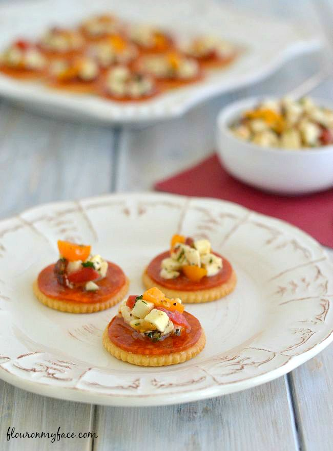Pepperoni Bruschetta Bites is a perfect snack recipe or appetizer recipe made with fresh mozzarella, olive oil and fresh herbs on a Ritz cracker  #ad #PutitonaRitz