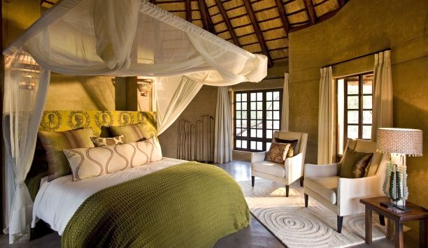 Vuyani Safari Lodge- beautiful suites with private patios and outdoor showers.