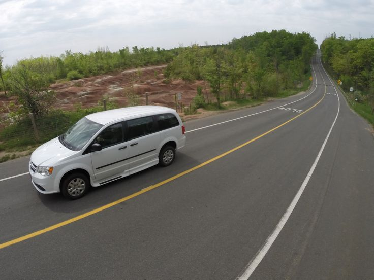 Full size side entry wheelchair conversion for Dodge van driving by Cheltenham Badlands