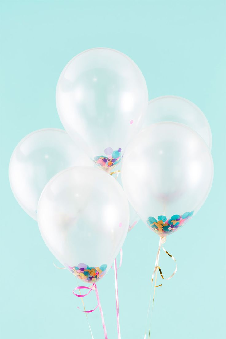 Make a set of DIY confetti fortune balloons for your New Year's Eve party with this festive project.