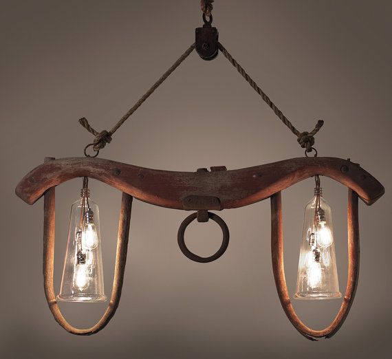 Ox Yoke Repurposed into One Of A Kind Chandelier very cool.