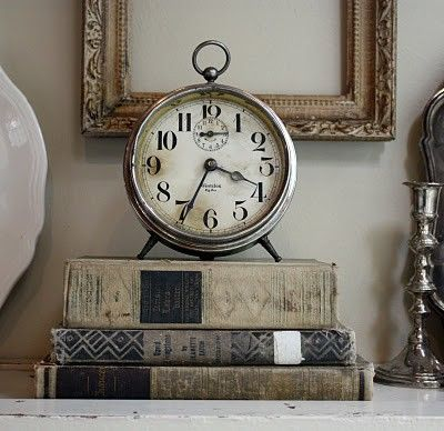 Clock and books vignette via Vintage Interior Blogs VI