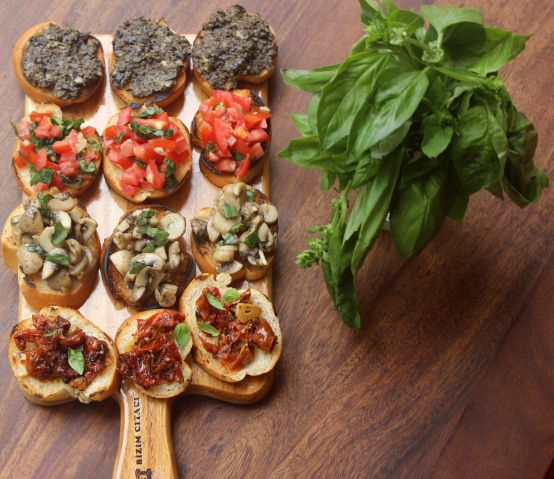 BRUSCHETTA PLATTER : Tomato & basil, Mushroom & thyme, Olive-caper tapenade, and oven-dried tomatoes.