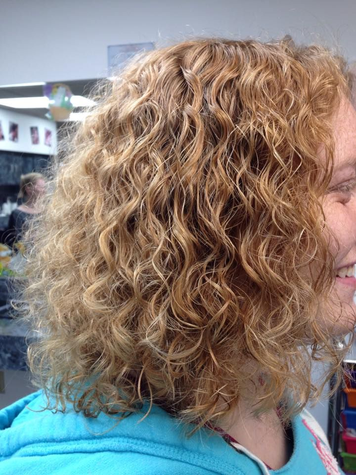 perm with looser curl in medium length