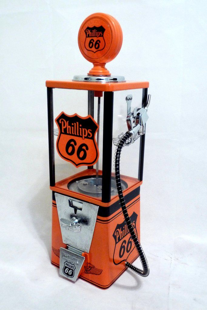 "that has been completely restored and themed to          PHILLIPS 66   This Machine comes complete with all original components including: * Machine Base & Body – Black & orange Gloss * 25 ¢ Coin Mechanism * Lock and key  * Original candy/ nuts  wheel *Lock and Key * gasoline pump hose and globe (plastic and rubber) machine  measure approx. 17"" Tall"