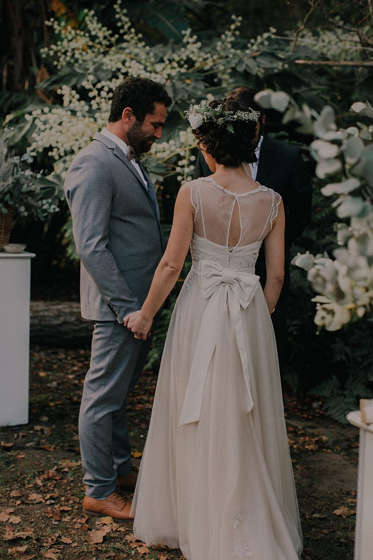 This bride re-designed her mother's original wedding dress and wore it on her special day. How beautiful! Love the big bow at the back. It's a whimsical dress, perfect for a garden wedding.