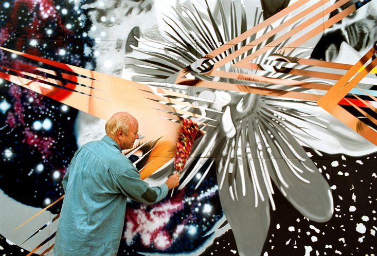 Rosenquist dusts one of his paintings at his Aripeka studio. The oil on canvas is called Though the Eye of the Needle to the Anvil.