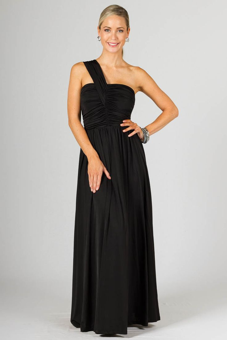 """Ashlyn Maxi Dress - Black - Paper Scissors Frock bridesmaids dress. A stunning Grecian inspired maxi with a gorgeous double layered full length skirt.  Single shoulder strap that runs diagnally over the back with a gathered feature at top.  Gathered through front of bodice to give a lovely drapey look and smocked through the back to allow a comfortable fit. This is a quality made frock that is perfect for a formal occasion or bridesmaids attire.  Made from Satin Jersey.  Pictured model 5'8""""."""