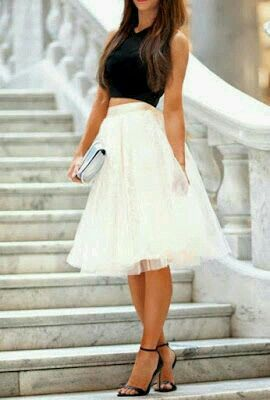 White tulle skirt and black crop top and heels!