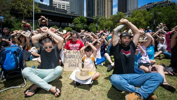 Hundreds protest at Circular Quay over Manus Island detainees. Protesters take part in a protest at First Fleet Park, Circular Quay, on Sunday, to show solidarity with the Manus ...