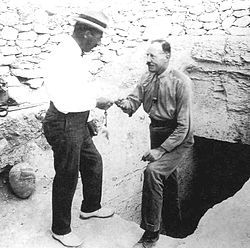 """Howard Carter and Lord Carnarvon at the entrance of the tomb of Tutankhamun, 1922. On 25 March 1923 Carnarvon suffered a severe mosquito bite infected by a razor cut. On 5 April, he died in the Continental-Savoy Hotel in Cairo.[10] This led to the story of the """"Curse of Tutankhamun"""", the """"Mummy's Curse"""". His death is most probably explained by blood poisoning (progressing to pneumonia) after accidentally shaving a mosquito bite infected with erysipelas."""