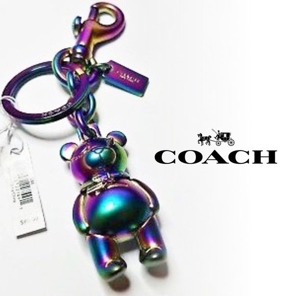 "Shop Women's Coach Green Purple size 4.25"" (length) Key & Card Holders at a discounted price at Poshmark. Description: Limited Edition and 100% authentic, this COACH hologram metal teddy bear keychain / bag charm was purchased by me at my local COACH store. It is NWT and comes with its original COACH dust bag. Style #F87166.. Sold by thundercat428. Fast delivery, full service customer support."