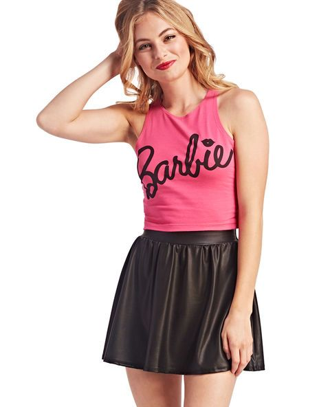 """<p>We're all just Barbie™ girls living in Barbie's™ world! Join the party when you rock this totally cute crop tank with Barbie™ screen printed across the front of a solid knit body in her fave signature pink! (Of course!) Other features include a high scoop neckline, a wide racer back, and a stretchy snug fit.</p>  <p>Model is 5'9"""" and wears a size small.</p>  <ul> <li>95% Cotton / 5% Spandex</li> <li>Machine Wash</li> <li>Imported</li> </ul>"""