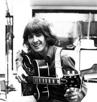 George singing with a smile