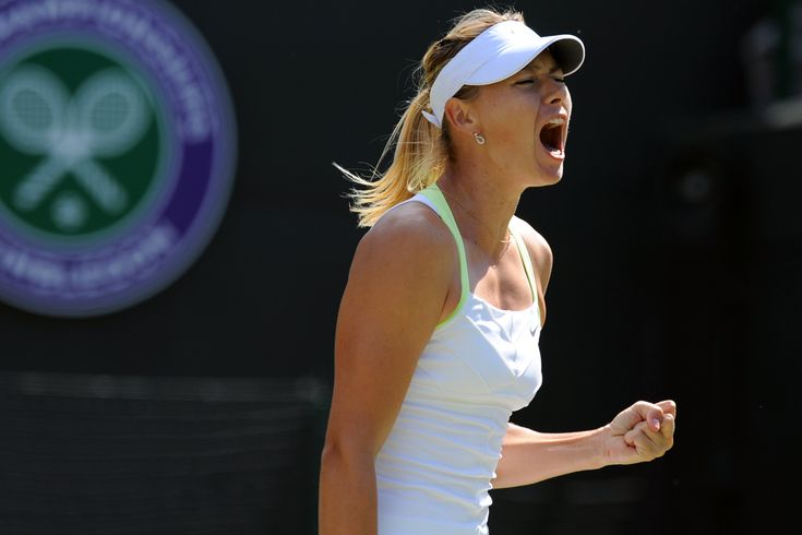 Maria Sharapova pumps her fist after taking a point from Su-Wei Hsieh.