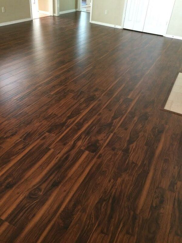 6 X 48 X 12mm Teak Laminate Flooring In Smooth Brown In 2020 Laminate Flooring Walnut Laminate Flooring Mahogany Flooring