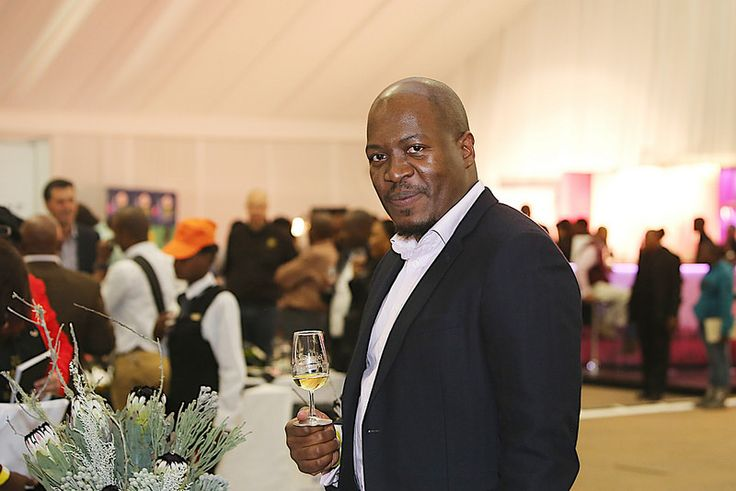 Mandisi Khumalo tastes wine at the 10th TOPS at SPAR Soweto Wine and Lifestyle Festival.