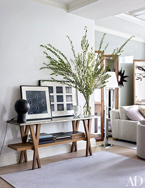 Shelton, Mindel & Associates | In the entry area, a vintage André Borderie table lamp mingles with artworks by Raoul Dufy (left) and Iran do Espírito Santo atop an Antonio Citterio console for Hermès | Grey, black, white, wood.