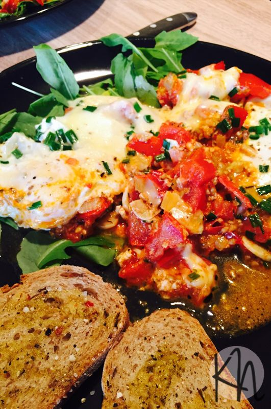 Szakszuszka that is poached eggs in tomato sauce :) Yummy