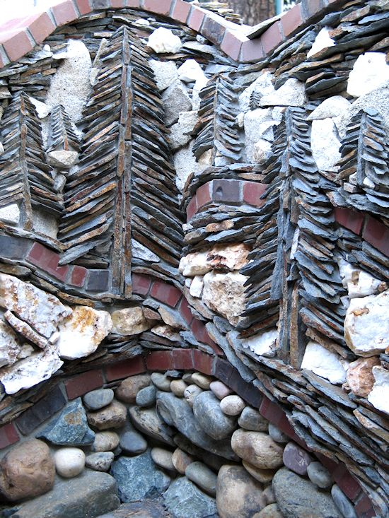 From piersonmasonry.com and called BASS LAKE.  Made from   quartz, brick, river rock, granite and ledger stone.