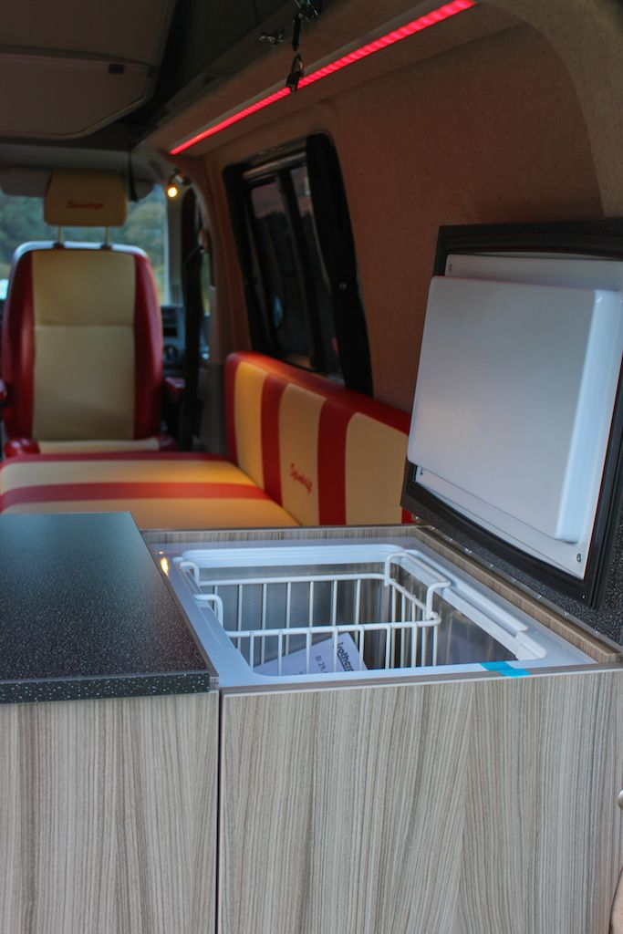 Webasto top loading fridge accessible inside & outside of the van.
